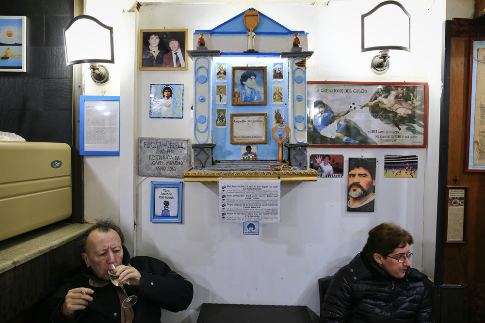 A votive shrine, dedicated to the football player Diego Armando Maradona, is displayed in a bar in downtown Naples, Italy February 14, 2018. REUTERS/Tony Gentile