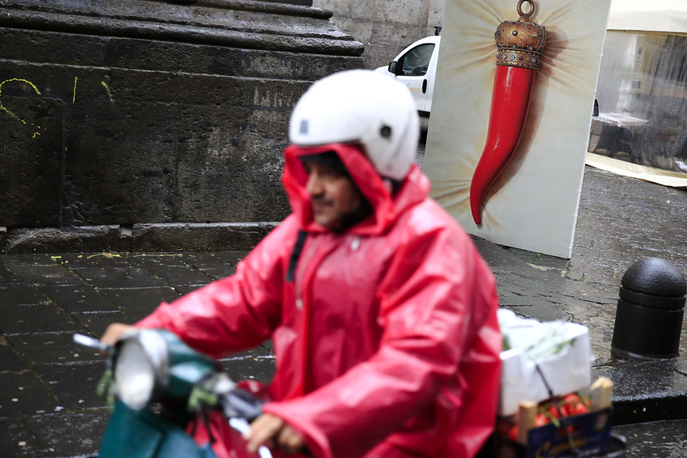 A man drives past a big red horn in downtown Naples, Italy February 14, 2018. REUTERS/Tony Gentile